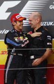 Sebastian Vettel of Germany and Red Bull Racing celebrates on the podium with Red Bull Racing Chief Technical Officer Adrian Newey after winning the...