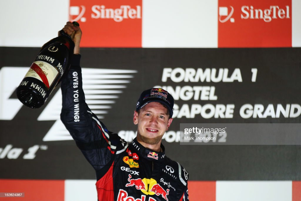 <a gi-track='captionPersonalityLinkClicked' href=/galleries/search?phrase=Sebastian+Vettel&family=editorial&specificpeople=2233605 ng-click='$event.stopPropagation()'>Sebastian Vettel</a> of Germany and Red Bull Racing celebrates on the podium after winning the Singapore Formula One Grand Prix at the Marina Bay Street Circuit on September 23, 2012 in Singapore, Singapore.