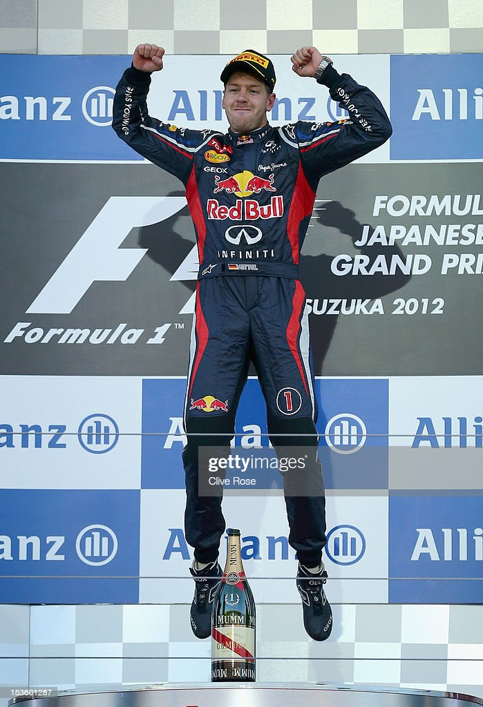 <a gi-track='captionPersonalityLinkClicked' href=/galleries/search?phrase=Sebastian+Vettel&family=editorial&specificpeople=2233605 ng-click='$event.stopPropagation()'>Sebastian Vettel</a> of Germany and Red Bull Racing celebrates on the podium after winning the Japanese Formula One Grand Prix at the Suzuka Circuit on October 7, 2012 in Suzuka, Japan.
