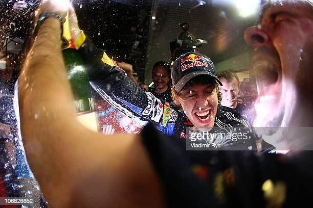 Sebastian Vettel of Germany and Red Bull Racing celebrates with his team after winning the driver's championship during the Abu Dhabi Formula One...