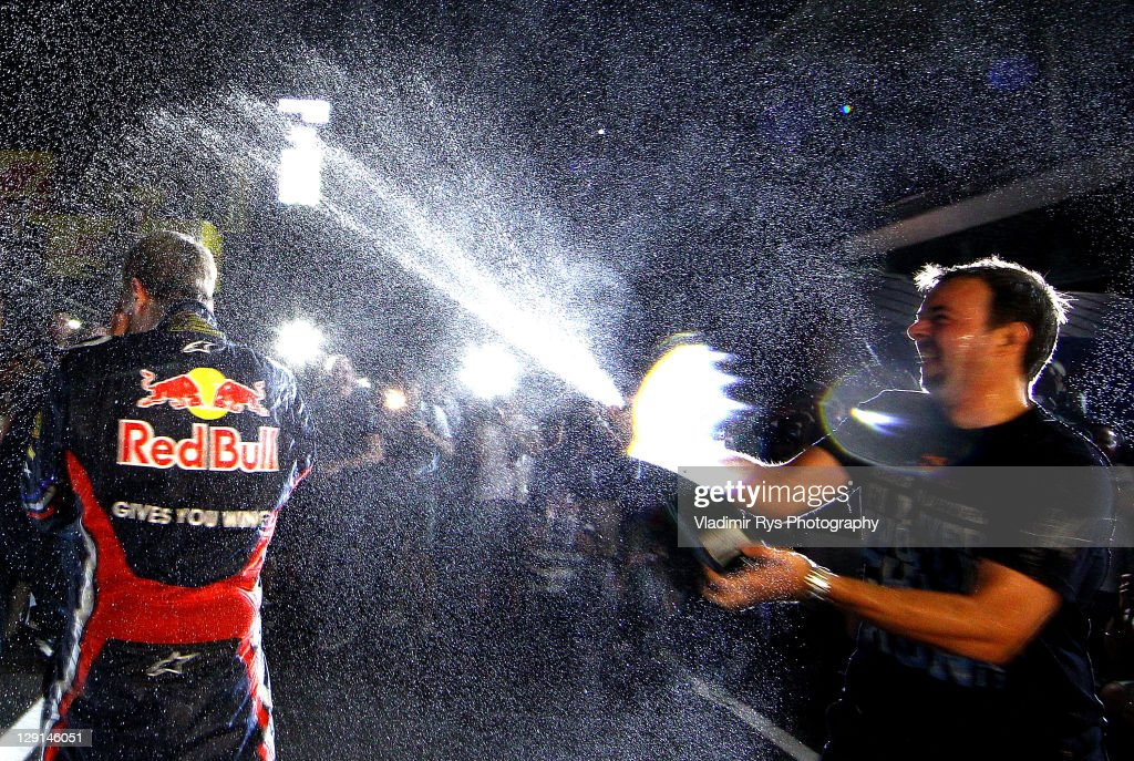 Sebastian Vettel of Germany and Red Bull Racing celebrates with his team after winning the Driver's Formula One Championship at the Formula One Grand Prix of Japan at Suzuka Circuit on October 9, 2011 in Suzuka, Japan.
