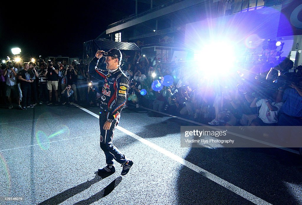 Sebastian Vettel of Germany and Red Bull Racing celebrates with his team after winning Driver's Formula One Championship during the Formula One Grand Prix of Japan at Suzuka Circuit on October 9, 2011 in Suzuka, Japan.