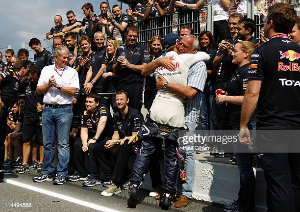 Sebastian Vettel of Germany and Red Bull Racing celebrates with Red Bull Racing team owner Dietrich Mateschitz and team mates in the pitlane after...