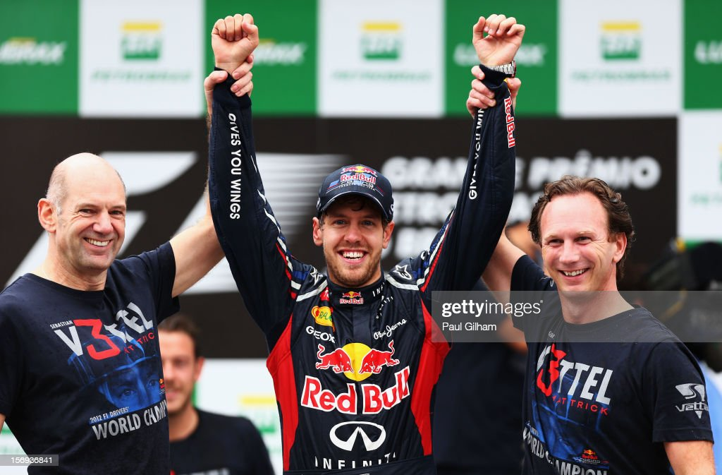 <a gi-track='captionPersonalityLinkClicked' href=/galleries/search?phrase=Sebastian+Vettel&family=editorial&specificpeople=2233605 ng-click='$event.stopPropagation()'>Sebastian Vettel</a> (C) of Germany and Red Bull Racing celebrates with Red Bull Racing Chief Technical Officer Adrian Newey (L) and Team Principal Christian Horner (R) on the podium as he finishes in sixth position and clinches his third consecutive drivers world championship during the Brazilian Formula One Grand Prix at the Autodromo Jose Carlos Pace on November 25, 2012 in Sao Paulo, Brazil.