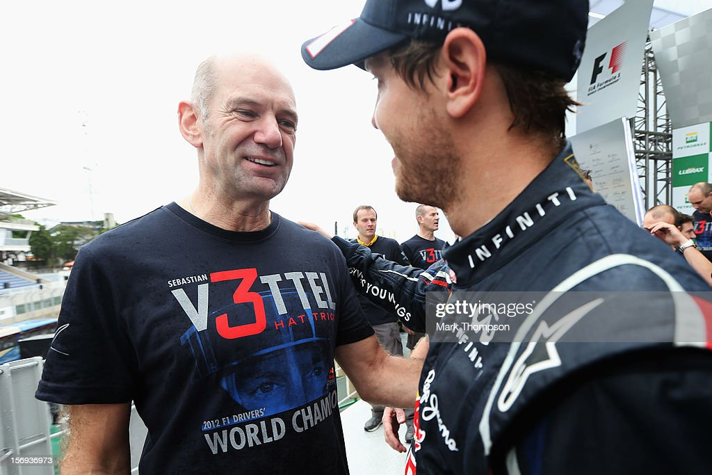 Sebastian Vettel (R) of Germany and Red Bull Racing celebrates with Red Bull Racing Chief Technical Officer Adrian Newey (L) on the podium as he finishes in sixth position and clinches his third consecutive drivers world championship during the Brazilian Formula One Grand Prix at the Autodromo Jose Carlos Pace on November 25, 2012 in Sao Paulo, Brazil.