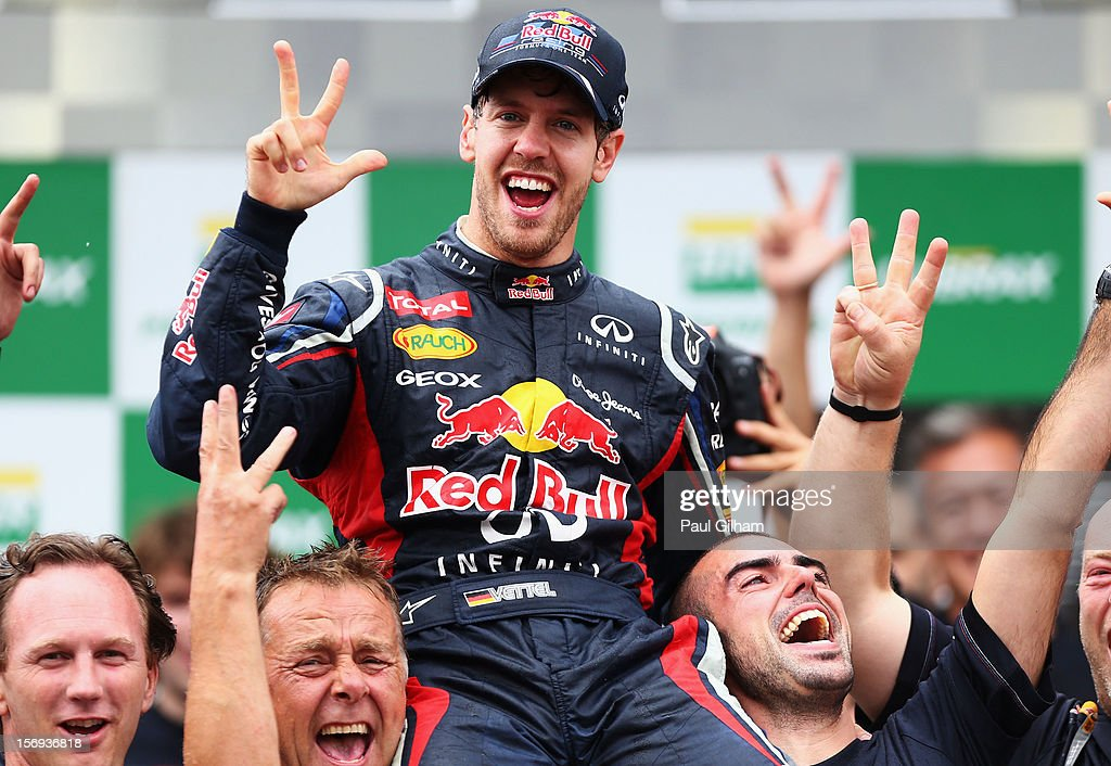 <a gi-track='captionPersonalityLinkClicked' href=/galleries/search?phrase=Sebastian+Vettel&family=editorial&specificpeople=2233605 ng-click='$event.stopPropagation()'>Sebastian Vettel</a> of Germany and Red Bull Racing celebrates with team mates on the podium as he finishes in sixth position and clinches his third consecutive drivers world championship during the Brazilian Formula One Grand Prix at the Autodromo Jose Carlos Pace on November 25, 2012 in Sao Paulo, Brazil.