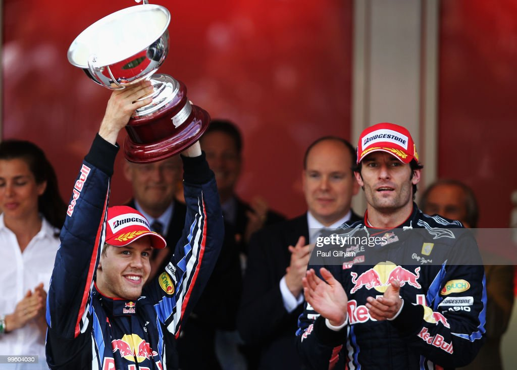 Sebastian Vettel (L) of Germany and Red Bull Racing celebrates with the trophy for finishing second during the Monaco Formula One Grand Prix at the Monte Carlo Circuit on May 16, 2010 in Monte Carlo, Monaco.