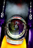 Sebastian Vettel of Germany and Red Bull Racing coolshis cockpit with dry ice during qualifying for the Singapore Formula One Grand Prix at Marina...