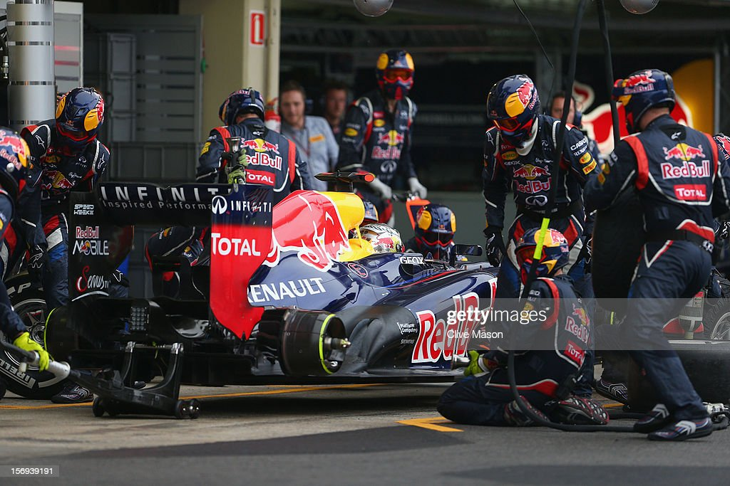 Sebastian Vettel of Germany and Red Bull Racing drives in for a pitstop on his way to finishing in sixth position and clinching the drivers world championship during the Brazilian Formula One Grand Prix at the Autodromo Jose Carlos Pace on November 25, 2012 in Sao Paulo, Brazil.