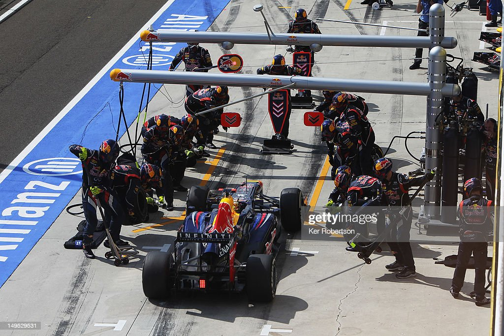 Sebastian Vettel of Germany and Red Bull Racing drives in for a pitstop during the Hungarian Formula One Grand Prix at the Hungaroring on July 29, 2012 in Budapest, Hungary.