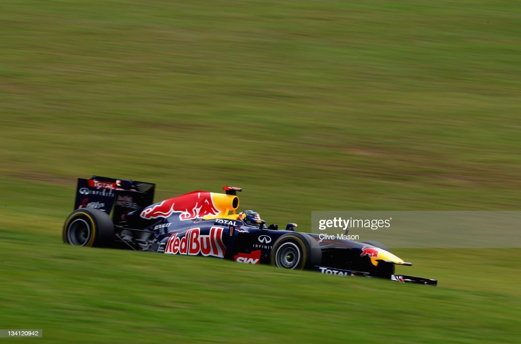 <a gi-track='captionPersonalityLinkClicked' href=/galleries/search?phrase=Sebastian+Vettel&family=editorial&specificpeople=2233605 ng-click='$event.stopPropagation()'>Sebastian Vettel</a> of Germany and Red Bull Racing drives on his way to taking pole position for the fifteenth time this season following qualifying for the Brazilian Formula One Grand Prix at the Autodromo Jose Carlos Pace on November 26, 2011 in Sao Paulo, Brazil.