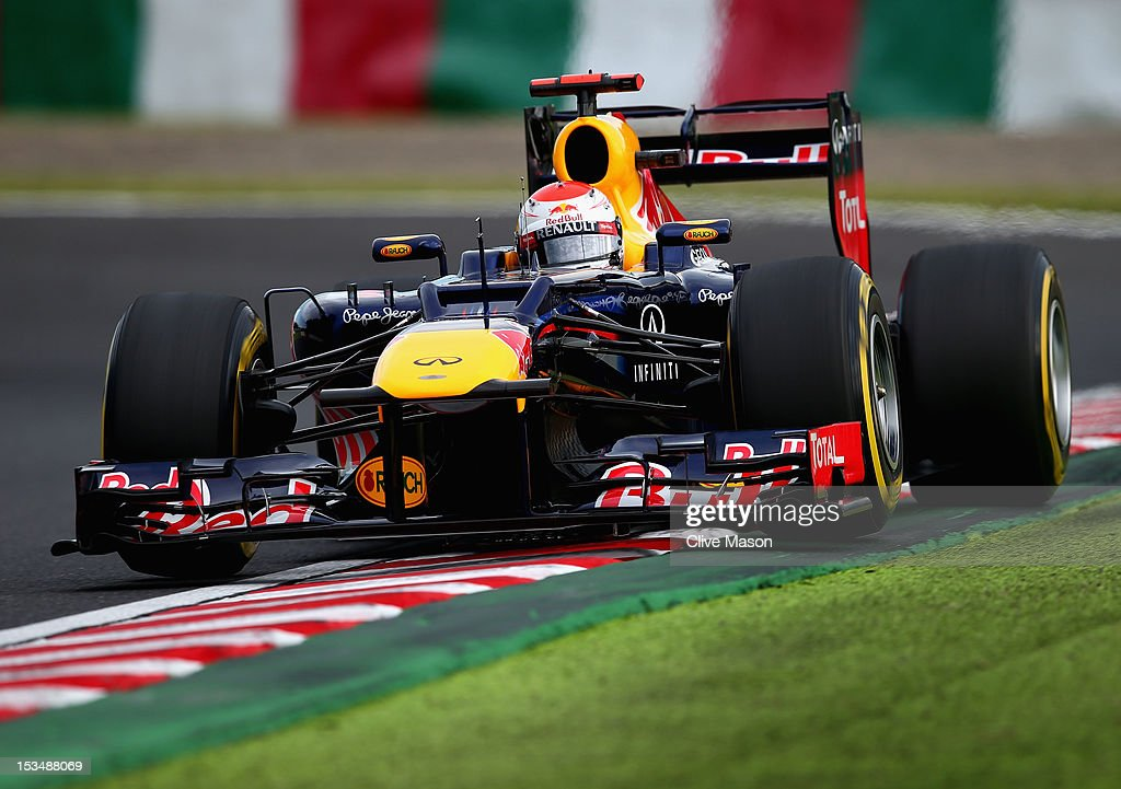 <a gi-track='captionPersonalityLinkClicked' href=/galleries/search?phrase=Sebastian+Vettel&family=editorial&specificpeople=2233605 ng-click='$event.stopPropagation()'>Sebastian Vettel</a> of Germany and Red Bull Racing drives on his way to finishing first during qualifying for the Japanese Formula One Grand Prix at the Suzuka Circuit on October 6, 2012 in Suzuka, Japan.