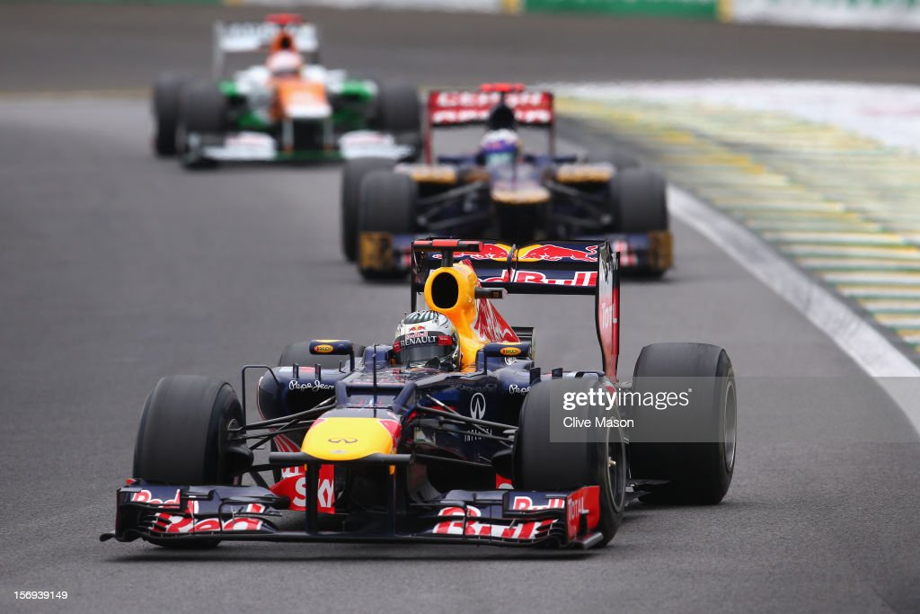 Sebastian Vettel of Germany and Red Bull Racing drives on his way to finishing in sixth position and clinching the drivers world championship during the Brazilian Formula One Grand Prix at the Autodromo Jose Carlos Pace on November 25, 2012 in Sao Paulo, Brazil.