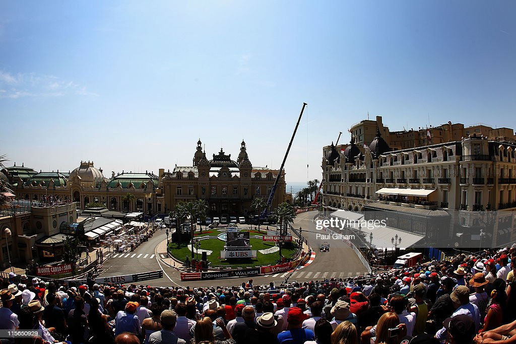 Sebastian Vettel of Germany and Red Bull Racing drives through Casino Square during practice for the Monaco Formula One Grand Prix at the Monte Carlo...