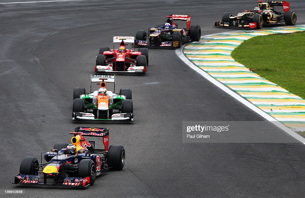 Sebastian Vettel of Germany and Red Bull Racing leads a train of cars through turn one and two during the Brazilian Formula One Grand Prix at the Autodromo Jose Carlos Pace on November 25, 2012 in Sao Paulo, Brazil.
