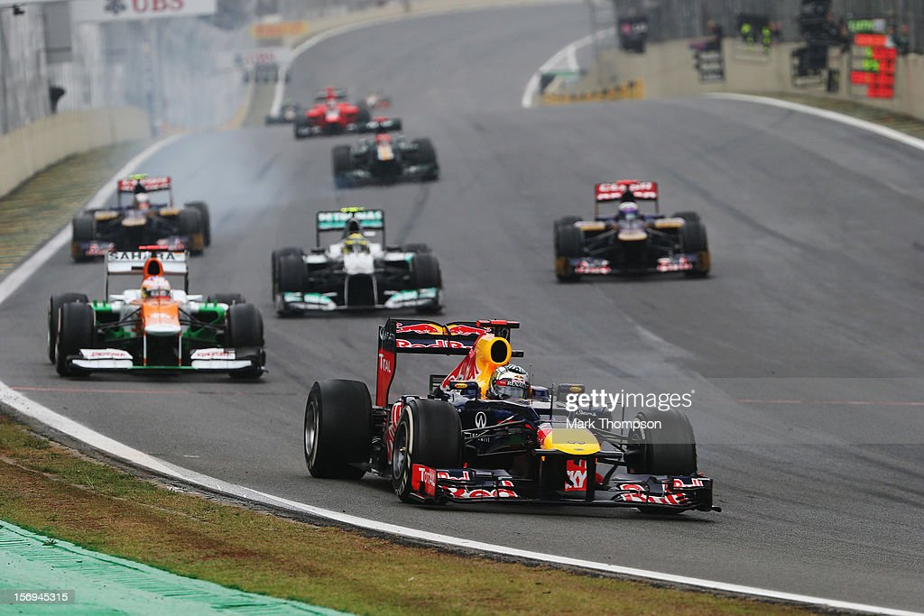 Sebastian Vettel of Germany and Red Bull Racing leads a train of cars through turn one during the Brazilian Formula One Grand Prix at the Autodromo Jose Carlos Pace on November 25, 2012 in Sao Paulo, Brazil.