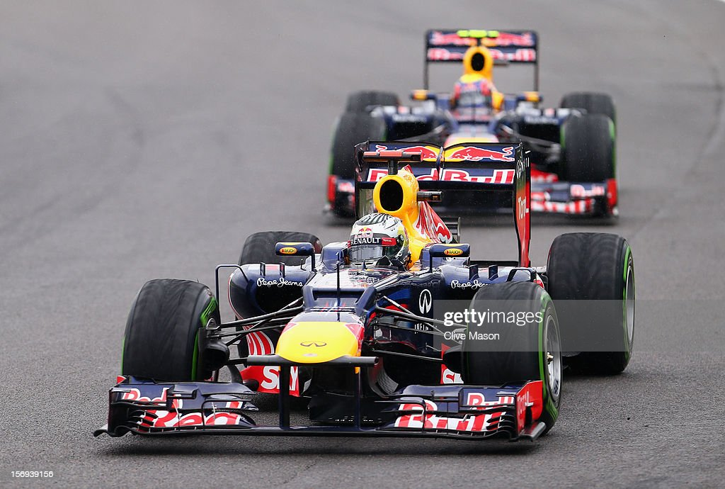 <a gi-track='captionPersonalityLinkClicked' href=/galleries/search?phrase=Sebastian+Vettel&family=editorial&specificpeople=2233605 ng-click='$event.stopPropagation()'>Sebastian Vettel</a> of Germany and Red Bull Racing leads from team mate <a gi-track='captionPersonalityLinkClicked' href=/galleries/search?phrase=Mark+Webber+-+Pilota+di+auto+da+corsa&family=editorial&specificpeople=167271 ng-click='$event.stopPropagation()'>Mark Webber</a> of Australia and Red Bull Racing as he drives on his way to finishing in sixth position and clinching the drivers world championship during the Brazilian Formula One Grand Prix at the Autodromo Jose Carlos Pace on November 25, 2012 in Sao Paulo, Brazil.
