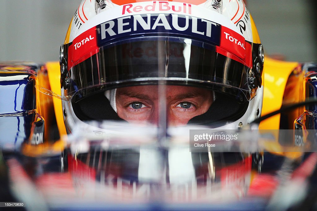 <a gi-track='captionPersonalityLinkClicked' href=/galleries/search?phrase=Sebastian+Vettel&family=editorial&specificpeople=2233605 ng-click='$event.stopPropagation()'>Sebastian Vettel</a> of Germany and Red Bull Racing prepares to drive during qualifying for the Japanese Formula One Grand Prix at the Suzuka Circuit on October 6, 2012 in Suzuka, Japan.