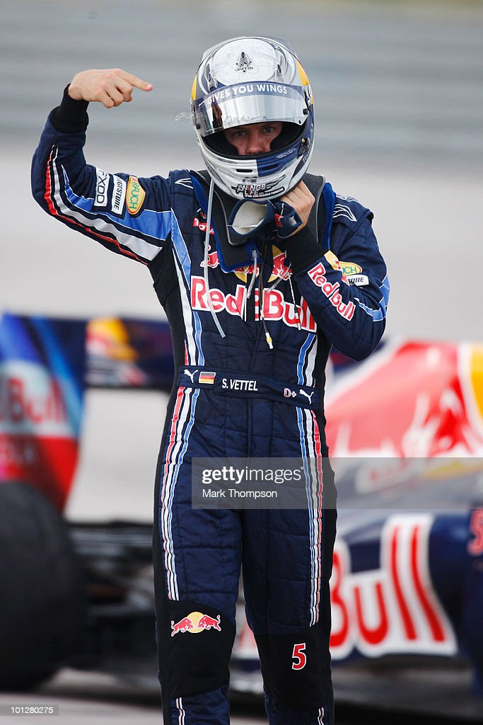 <a gi-track='captionPersonalityLinkClicked' href=/galleries/search?phrase=Sebastian+Vettel&family=editorial&specificpeople=2233605 ng-click='$event.stopPropagation()'>Sebastian Vettel</a> of Germany and Red Bull Racing reacts as he crashes out after colliding with his team mate Mark Webber of Australia and Red Bull Racing during the Turkish Formula One Grand Prix at Istanbul Park on May 30, 2010, in Istanbul, Turkey.