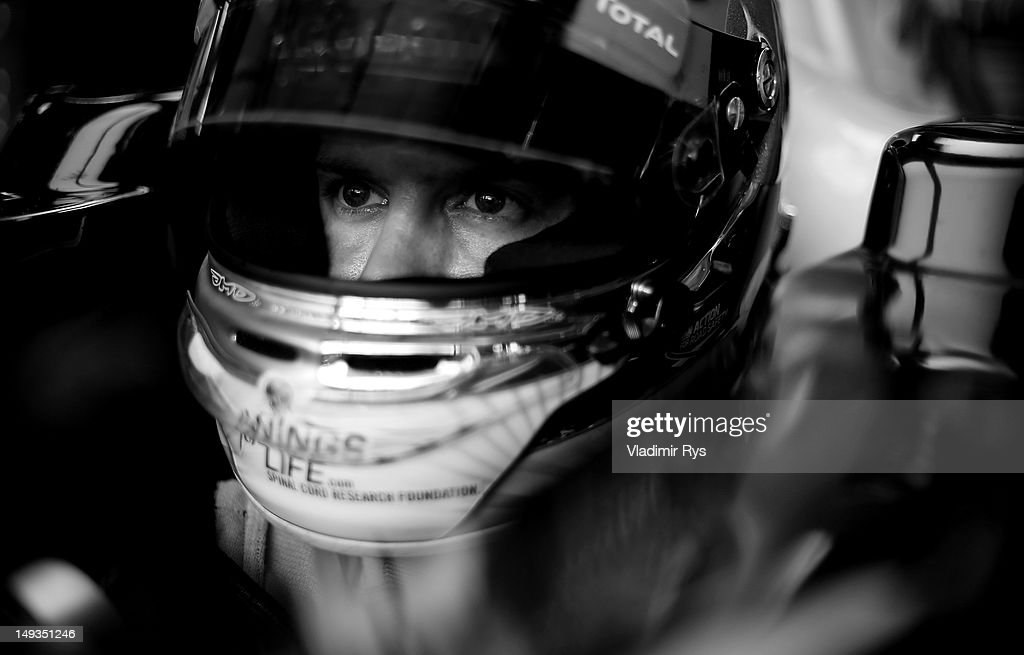 <a gi-track='captionPersonalityLinkClicked' href=/galleries/search?phrase=Sebastian+Vettel&family=editorial&specificpeople=2233605 ng-click='$event.stopPropagation()'>Sebastian Vettel</a> of Germany and Red Bull Racing sits in his car in the garage during practice for the Hungarian Formula One Grand Prix at the Hungaroring on July 27, 2012 in Budapest, Hungary.