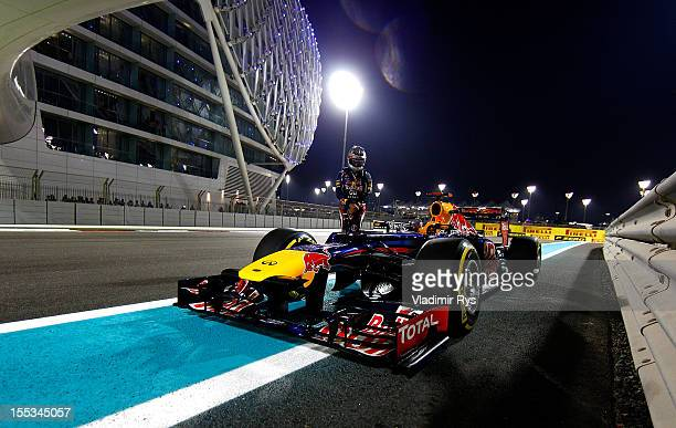 Sebastian Vettel of Germany and Red Bull Racing stands next to his car on the track after qualifying for the Abu Dhabi Formula One Grand Prix at the...