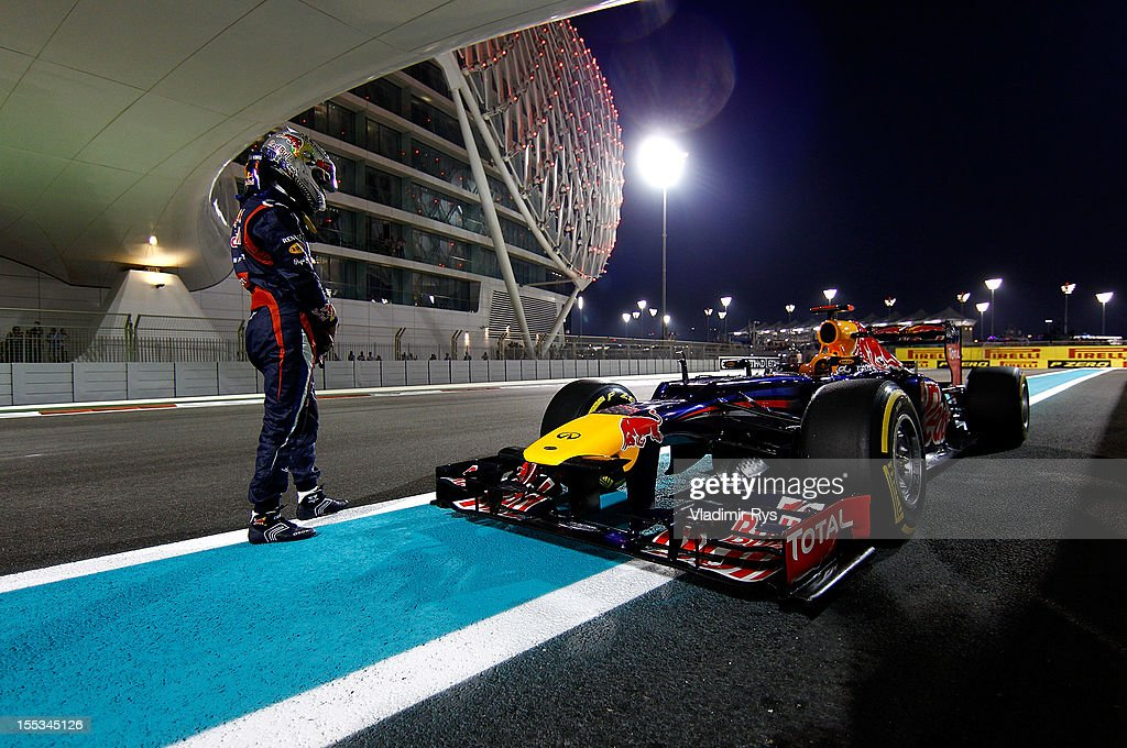 <a gi-track='captionPersonalityLinkClicked' href=/galleries/search?phrase=Sebastian+Vettel&family=editorial&specificpeople=2233605 ng-click='$event.stopPropagation()'>Sebastian Vettel</a> of Germany and Red Bull Racing stands next to his car on the track after qualifying for the Abu Dhabi Formula One Grand Prix at the Yas Marina Circuit on November 3, 2012 in Abu Dhabi, United Arab Emirates.