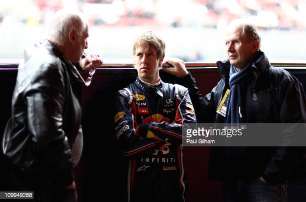 Sebastian Vettel of Germany and Red Bull Racing talks with Red Bull Racing Motorsport Consultant Dr Helmut Marko and Red Bull Racing team owner...