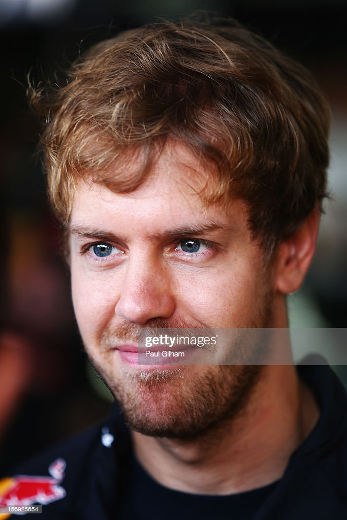 Sebastian Vettel of Germany and Red Bull Racing talks with team mates in the pitlane before the Brazilian Formula One Grand Prix at the Autodromo Jose Carlos Pace on November 25, 2012 in Sao Paulo, Brazil.