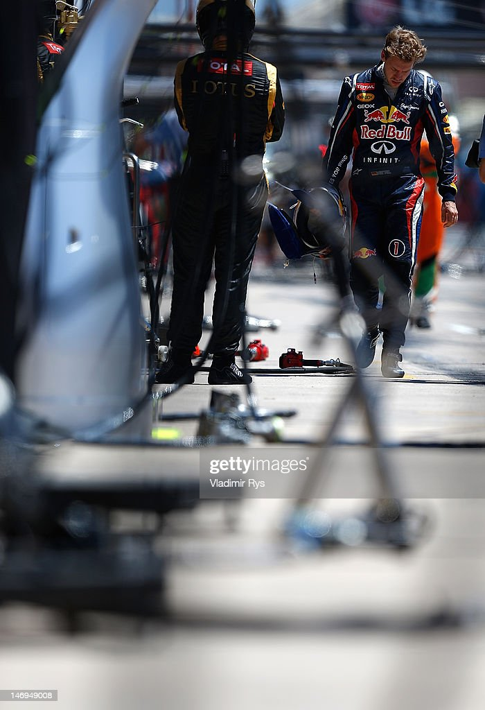 <a gi-track='captionPersonalityLinkClicked' href=/galleries/search?phrase=Sebastian+Vettel&family=editorial&specificpeople=2233605 ng-click='$event.stopPropagation()'>Sebastian Vettel</a> of Germany and Red Bull Racing walks back to the garage after he retired during the European Grand Prix at the Valencia Street Circuit on June 24, 2012 in Valencia, Spain.