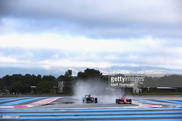 Sebastian Vettel of Germany and Scuderia Ferrari and Stoffel Vandoorne of Belgium and McLaren Honda drive during wet weather tyre testing at Circuit...