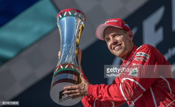 Sebastian Vettel of Germany and Scuderia Ferrari with the trophy at Pirelli Hungarian Formula 1 Grand Prix on Jul 30 2017 in Mogyoród Hungary