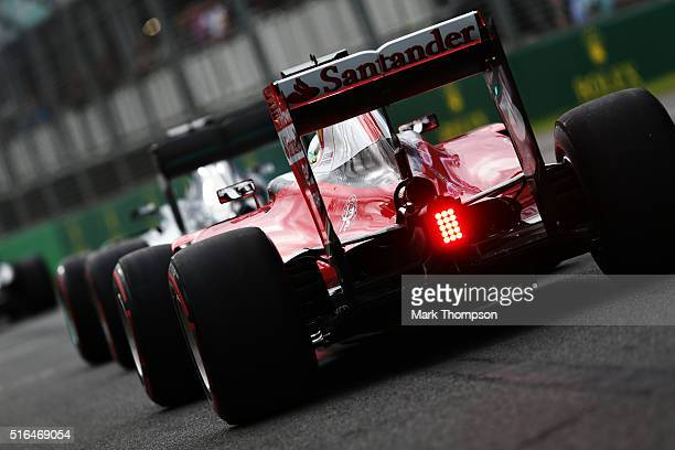 Sebastian Vettel of Germany drives the Scuderia Ferrari SF16H Ferrari 059/5 turbo in the Pitlane during qualifying for the Australian Formula One...