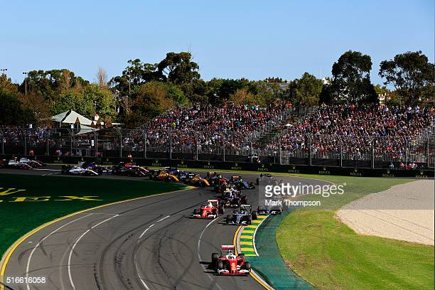 Sebastian Vettel of Germany drives the Scuderia Ferrari SF16H Ferrari 059/5 turbo leads the field at the start during the Australian Formula One...