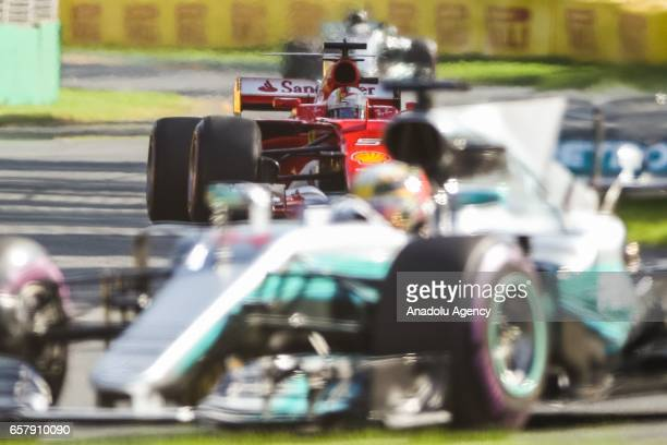 Sebastian Vettel of Germany driving for Scuderia Ferrari chases Lewis Hamilton of the United Kingdom driving for Mercedes AMG Petronas during the...