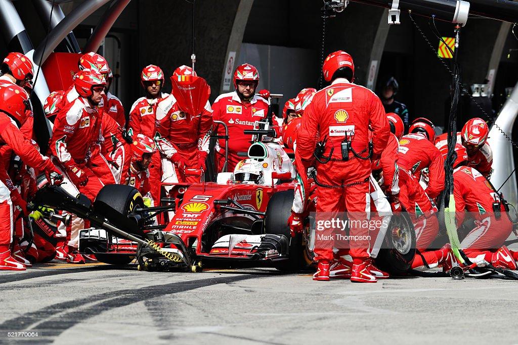 Sebastian Vettel of Germany driving the Scuderia Ferrari SF16H Ferrari 059/5 turbo makes a pitstop for new tyres during the Formula One Grand Prix of...