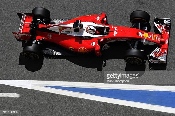 Sebastian Vettel of Germany driving the Scuderia Ferrari SF16H Ferrari 059/5 turbo in the Pitlane during practice for the Spanish Formula One Grand...