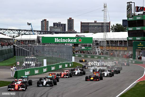 Sebastian Vettel of Germany driving the Scuderia Ferrari SF16H Ferrari 059/5 turbo leads Nico Rosberg of Germany driving the Mercedes AMG Petronas F1...