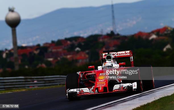 Sebastian Vettel of Germany driving the Scuderia Ferrari SF16H Ferrari 059/5 turbo on track during practice for the Formula One Grand Prix of Hungary...