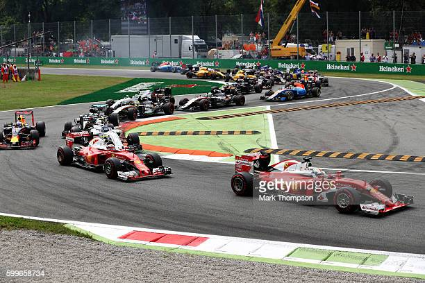 Sebastian Vettel of Germany driving the Scuderia Ferrari SF16H Ferrari 059/5 turbo leads Kimi Raikkonen of Finland driving the Scuderia Ferrari SF16H...