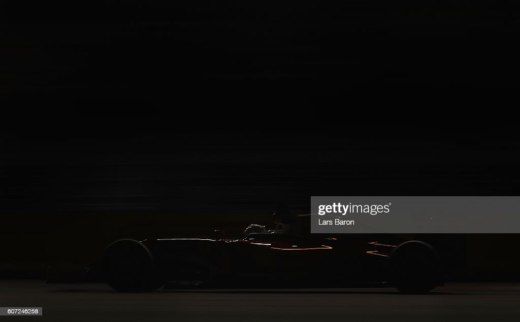 Sebastian Vettel of Germany driving the (5) Scuderia Ferrari SF16-H Ferrari 059/5 turbo (Shell GP) on track during qualifying for the Formula One Grand Prix of Singapore at Marina Bay Street Circuit on September 17, 2016 in Singapore.