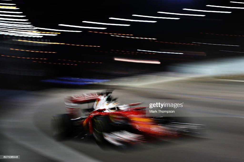 Sebastian Vettel of Germany driving the (5) Scuderia Ferrari SF16-H Ferrari 059/5 turbo (Shell GP) on track during the Formula One Grand Prix of Singapore at Marina Bay Street Circuit on September 18, 2016 in Singapore.