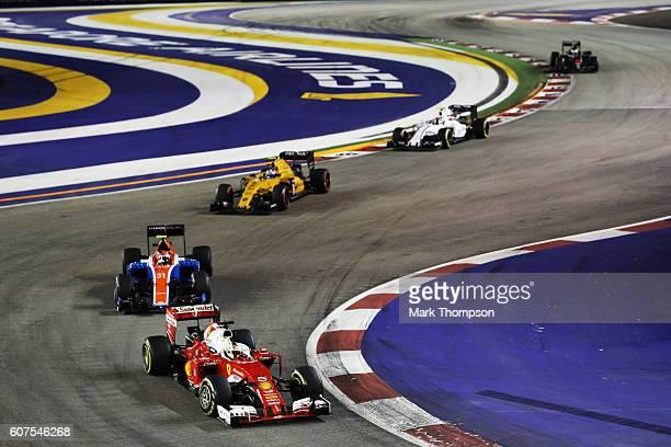 Sebastian Vettel of Germany driving the Scuderia Ferrari SF16H Ferrari 059/5 turbo leads Esteban Ocon of France driving the Manor Racing MRTMercedes...