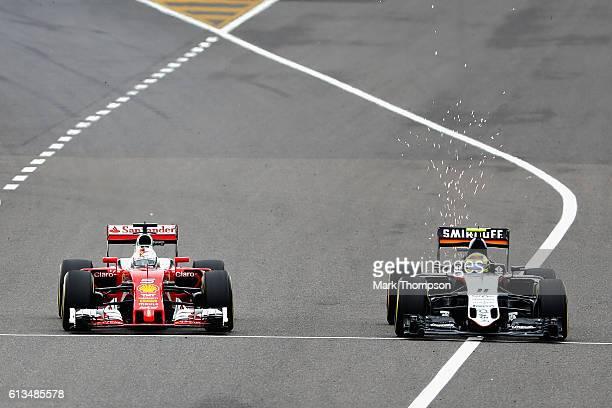 Sebastian Vettel of Germany driving the Scuderia Ferrari SF16H Ferrari 059/5 turbo battles for position with Sergio Perez of Mexico driving the...