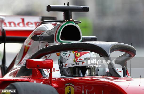Sebastian Vettel of Germany driving the Scuderia Ferrari SF16H Ferrari 059/5 turbo in the Pitlane with the halo fitted during practice for the Abu...