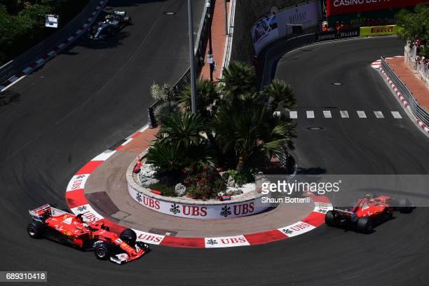 Sebastian Vettel of Germany driving the Scuderia Ferrari SF70H and Kimi Raikkonen of Finland driving the Scuderia Ferrari SF70H round the hairpin...