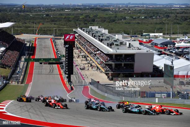 Sebastian Vettel of Germany driving the Scuderia Ferrari SF70H and Lewis Hamilton of Great Britain driving the Mercedes AMG Petronas F1 Team Mercedes...