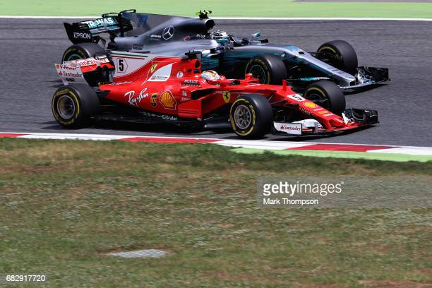 Sebastian Vettel of Germany driving the Scuderia Ferrari SF70H battles for position with Valtteri Bottas driving the Mercedes AMG Petronas F1 Team...
