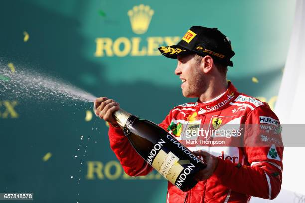 Sebastian Vettel of Germany driving the Scuderia Ferrari SF70H celebrates his win on the podium during the Australian Formula One Grand Prix at...