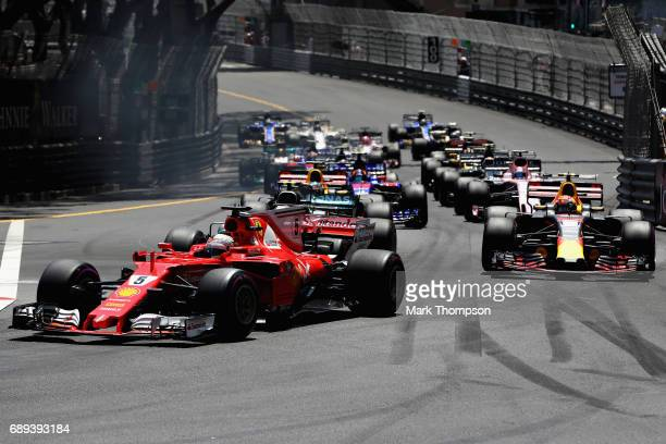 Sebastian Vettel of Germany driving the Scuderia Ferrari SF70H leads Max Verstappen of the Netherlands driving the Red Bull Racing Red BullTAG Heuer...