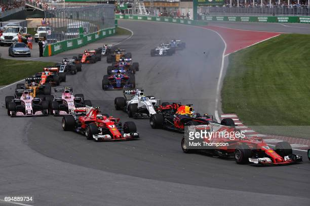 Sebastian Vettel of Germany driving the Scuderia Ferrari SF70H leads Daniel Ricciardo of Australia driving the Red Bull Racing Red BullTAG Heuer RB13...
